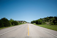 The open road on Highway 281 just North of Hill Country, Texas, April 26, 2010. The historic highway offers many attractions including Fossil Rim Nature Park, many spring time flowers, and a wonderful view of hill country in central Texas...PHOTOS/ MATT NAGER