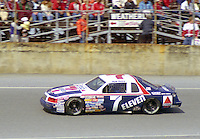 Kyle Petty 7 Ford Thunderbird action Daytona 500 at Daytona International Speedway in Daytona Beach, FL in February 1986. (Photo by Brian Cleary/www.bcpix.com) Daytona 500, Daytona International Speedway, Daytona Beach, FL, February 16, 1986.  (Photo by Brian Cleary/www.bcpix.com)