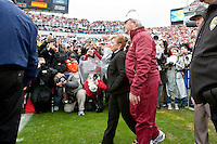 January 01, 2010:    Florida State head coach enters the field with his wife Ann prior to the start of the Konica Minolta Gator Bowl College football action between the West Virginia Mountaineers and the Florida State Seminoles played at the Jacksonville Municipal Stadium in Jacksonville, Florida on January 01, 2010.  Florida State defeated West Virginia 33-21.