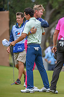 Trey Mullinax (USA) and Joaquin Niemann (CHL) congratulate each other following Round 3 of the Valero Texas Open, AT&amp;T Oaks Course, TPC San Antonio, San Antonio, Texas, USA. 4/21/2018.<br /> Picture: Golffile | Ken Murray<br /> <br /> <br /> All photo usage must carry mandatory copyright credit (&copy; Golffile | Ken Murray)