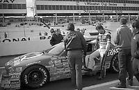 Ricky Rudd climbs into car 26 Buick 14th place Atlanta Journal 500 at Atlanta International Raceway in Hampton , GA on November 19, 1989.  (Photo by Brian Cleary/www.bcpix.com)