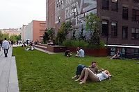 New York, NY -  10 June 2011 Park goers relax on the lawn near the Cost Rev graffiti...New York, NY -  10 June 2011 Section 2 of the Highline  opened to the public June 8th. The opening of the new section doubles the length of the public park. After years of planning, design and construction, the High Line is now one mile long, running from Gansevoort Street to West 30th Street, connecting the Meatpacking District, West Chelsea, and Hell's Kitchen.