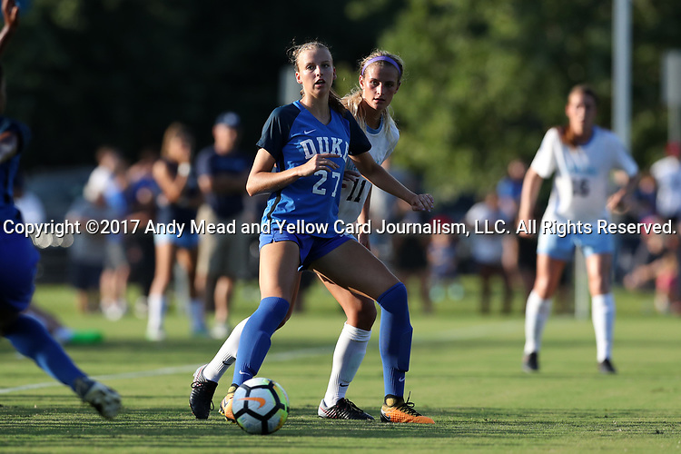 CARY, NC - AUGUST 18: Duke's Natasha Turner (27) and North Carolina's Emily Fox (11). The University of North Carolina Tar Heels hosted the Duke University Blue Devils on August 18, 2017, at Koka Booth Stadium in Cary, NC in a Division I college soccer game.