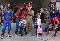 NWA Democrat-Gazette/DAVID GOTTSCHALK Lee the Lion (center) stands with costumed curriculum and instruction students with the University of Arkansas greet students and parents Tuesday, August 13, 2019, at Lee Elementary School in Springdale. Tuesday was the first day of the school year for the Springdale School District.