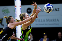 Lisa Mather fouls Maddy Gordon during the ANZ Premiership netball match between Central Pulse and WBOP Magic at TSB Bank Arena in Wellington, New Zealand on Sunday, 21 April 2019. Photo: Dave Lintott / lintottphoto.co.nz