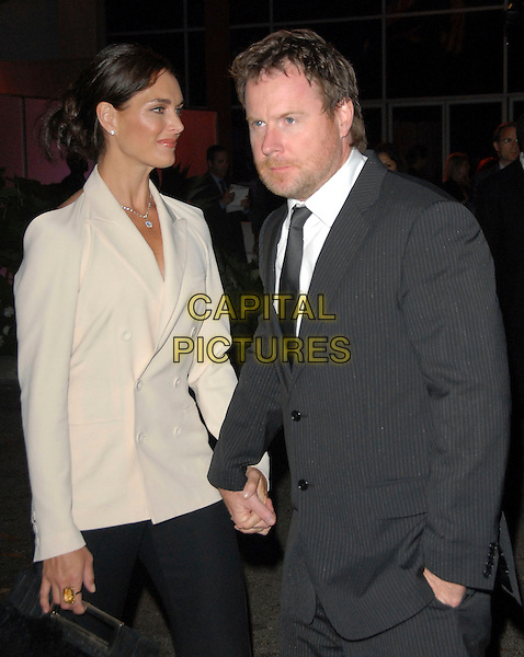 BROOKE SHIELDS & CHRIS HENCHY .attends The Beckham's Welcome to America Party hosted by Tom Cruise, Katie Holmes,Jada Pinkett Smith & Will Smith held at MOCA Geffen in Los Angeles, California, USA,  July 22 2007.                                                                                                                                                                             LA half length holding hands couple black suit trousers cream jacket grey.CAP/DVS.©Debbie VanStory/Capital Pictures