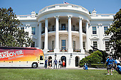 First Lady Michelle Obama participates in the filming of an episode of Extreme Makeover: Home Edition on the South Lawn of the White House, July 27, 2011. .Mandatory Credit: Samantha Appleton - White House via CNP