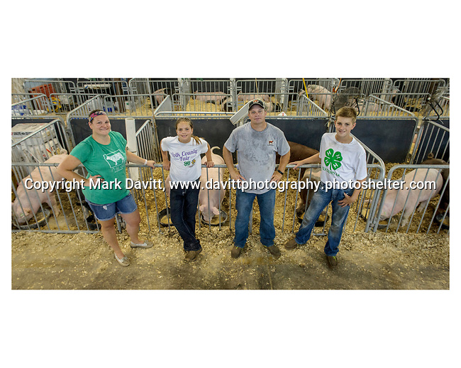 It all in the family for the Sanny's of Bondurant. They are from left, Stacia, mother, Elise, daughter, Eric, father, and Carter, son. The children participate in showing cattle, pigs and exhibits.
