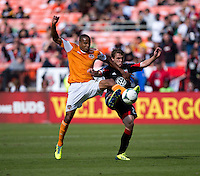 Ricardo Clark (13) of the Houston Dynamo fights for the ball with Jared Jeffrey (25) of D.C. United during a Major League Soccer game at RFK Stadium in Washington, DC. D.C. United vs. Houston Dynamo, 2-1.