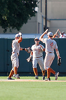Texas Longhorns outfielders Ben Johnson (14), Mark Payton (2) and Collin Shaw (4) celebrate after winning the NCAA baseball game against the Houston Cougars on June 6, 2014 at UFCU Disch–Falk Field in Austin, Texas. The Longhorns defeated the Cougars 4-2 in Game 1 of the NCAA Super Regional. (Andrew Woolley/Four Seam Images)