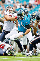November 27, 2011:  Jacksonville Jaguars quarterback Blaine Gabbert (11) is tackled after throwing the ball by Houston Texans center Chris Myers (55) during first half action between the Jacksonville Jaguars and the Houston Texans played at EverBank Field in Jacksonville, Florida.  ........