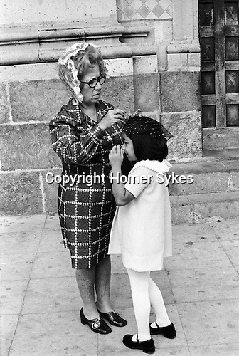 Mazatlan Mexico 1973. Mother and daughter outside church getting ready to go in.