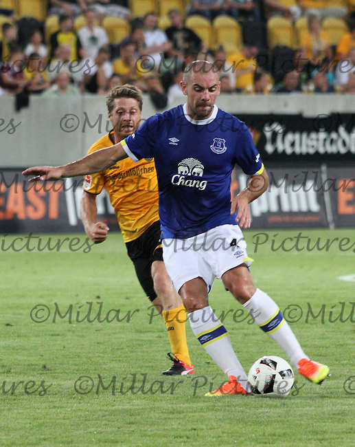 Darron Gibson being pressured into the back pass by Andreas Lambertz in the Dynamo Dresden v Everton match in the Bundeswehr Karriere Cup Dresden 2016 played at the DDV Stadion, Dresden on 29.7.16.
