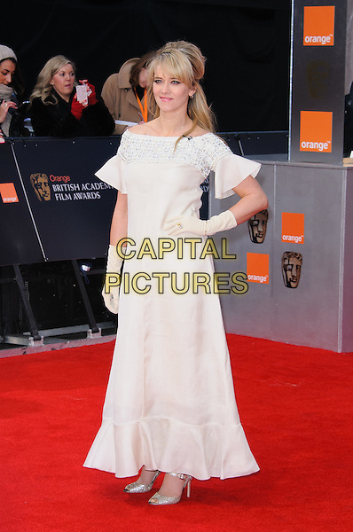 Edith Bowman.The Orange British Academy Film Awards ( BAFTA ), Royal Opera House, Bow St., London, England..February 12th, 2012.baftas full length white dress hand on hip gloves  .CAP/CJ.©Chris Joseph/Capital Pictures.