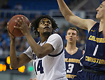 Nevada guard Lindsey Drew (14) looks to shoot over            Colorado Christian forward Aiden Cantwell (1) during the first half of an NCAA college basketball game in Reno, Nev., Wednesday, Oct. 30, 2019.
