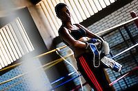 Geraldin Hamann, a young Colombian boxer, is seen after a shadowboxing session in the boxing gym in Cali, Colombia, 26 June 2013. During the recent years, Kina Malpartida, a Peruvian female professional boxer, has won the World Championship title several times and so she has become a sporting idol and an inspiration for a generation of young girls throughout Latin America. Working out hard in poorly equipped gyms, they dream of becoming a boxing star. The Cauca Valley and the Caribbean coast are believed to be a home of the most talented female boxers in Colombia.