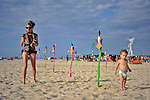"""Participant and her baby boy at """"Mid Burn"""", the Israeli """"Burning Man Festival"""" held at """"Habonim"""" beach north of Israel October 4-6, 2012."""
