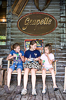 Haley (11), Rachel (14), and Emily Park (8) enjoy the back porch of  the Mast General Store in Valle Crucis, NC.