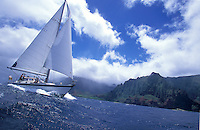 Group sailing a 48 foot cruising yacht off the Na Pali Coast, North Shore of Kauai, Hawaii