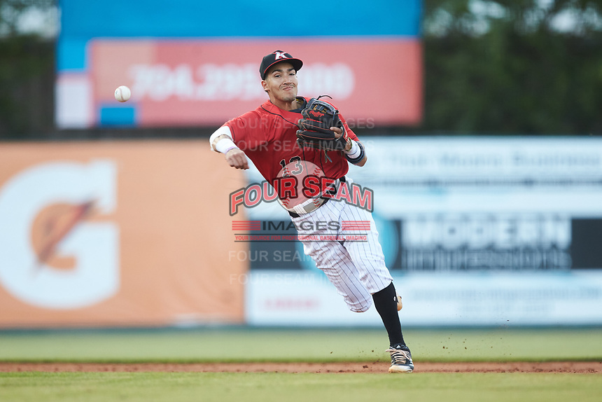 Kannapolis Intimidators shortstop Laz Rivera (13) makes a throw to first base against the Hickory Crawdads at Kannapolis Intimidators Stadium on May 19, 2018 in Kannapolis, North Carolina.  (Brian Westerholt/Four Seam Images)