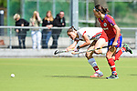 Mannheim, Germany, April 18: During the 1. Bundesliga Damen match between TSV Mannheim (white) and Mannheimer HC (red) on April 18, 2015 at TSV Mannheim in Mannheim, Germany. Final score 1-7 (1-4). (Photo by Dirk Markgraf / www.265-images.com) *** Local caption *** Laura Keibel #17 of TSV Mannheim, Nikki Kidd #26 of Mannheimer HC