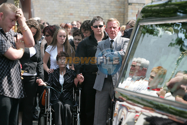 The Funeral of Emma McLoughlin who was stabbed to death last friday night outside a local supermarket in Laytown. Her Family follow her remains out of the church as her brother and Boyfriend carry her remains..Photo: Fran Caffrey/ Newsfile.