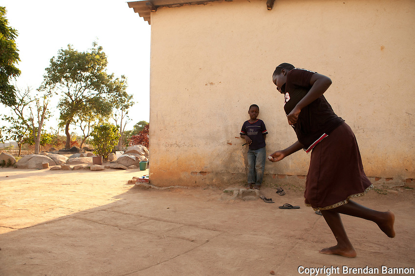 "Vimbai Chitani playing ""hop, skip and jump"" with her siblings at home. Vimbai Chitani (15) is a patient enrolled in the MSF HIV/AIDS project in Epworth, an urban settlement adjacent to the capital Harare of Zimbabwe. ""In 2007 I was very ill. I had rashes all over my body and my whole body ached. A week after I started medication I was already feeling much better. Now, I am anxious that my mother may send me to my grandmother in the countryside as we cannot afford my school anymore."".With 14.3 per cent prevalence rate (UNAIDS 2009), Zimbabwe is one of the countries worst affected by the worldwide HIV/AIDS epidemic. Since 2007, MSF has been running an HIV/AIDS project in Epworth. In August 2011, MSF had 12,864 patients under care in both of its clinics there."