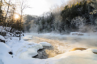 A beautiful winter morning with fog rising from the Menominee River at Piers Gorge. Menominee, MI
