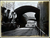 BNPS.co.uk (01202 558833)<br /> Pic: Nosb&uuml;sch&amp;Stucke/BNPS<br /> <br /> The Argyle Cut, Sydney.<br /> <br /> A stunning collection of photographs of Sydney decades before the iconic harbour bridge and opera house were built has been unearthed after 129 years.<br /> <br /> The black and white photo album captures the bustling city centre, picturesque main harbour and famous beaches of the future tourist hot-spot. <br /> <br /> The photos were taken by celebrated Australian photographer Henry King in 1888 who was born in England but emigrated to Australia at a young age and spent the rest of his life there.<br /> <br /> More recently they have fallen into the hands of a German collector who has decided to put them on the market and they are tipped to sell for &pound;1,800.<br /> <br /> Many of Sydney's most recognisable landmarks including Manly beach and Coogee bay look very different to what backpackers would encounter today.<br /> <br /> King also took various photos of Circular Quay - the city's main harbour - but missing from them are images of the Sydney Harbour Bridge and Sydney Opera House as these landmarks were both not built until well into the 20th century.