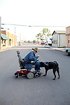 "Eldon Zimmerman, who refers to himself as ""Cowboy,"" walks with Bear, his 13-year-old Husky Chow mix in Whitehall, Montana August 23, 2011. Cowboy and Bear travel the town every day, even when the streets are covered in snow. ""That dog's not my companion, he's my life support. The doctor said he keeps me alive. Without Bear along with me, I will lay down and die,"" he said. Cowboy has diabetes and has already lost a toe to the disease. Cowboy was born in Charleston and at the age of 14, he left his family and made his way all the way to Montana where he was unofficially adopted by another family that took him in. About the South, Cowboy said, ""I don't miss it, I'm a cowboy now.""..Cowboy was born in 1951 and spent 11 years in prison. ..Whitehall's population was just over 1,000 in the 2000 census."
