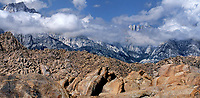 902000036 panoramic view -  mount whitney and the eastern sierras break through the clouds of a clearing storm seen from the alabama hills near lone pine california