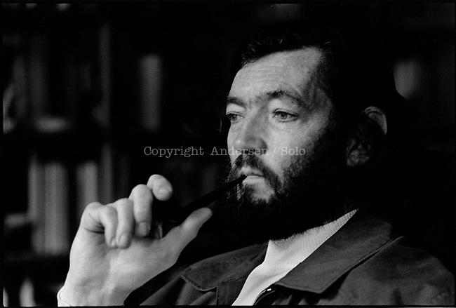 Julio Cortazar ( 1914-1984 ) at home in Paris.