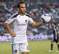 LA Galaxy midfielder Landon Donovan (10) chases down a loose ball. The LA Galaxy and the San Jose Earthquakes played to a 2-2 draw at Home Depot Center stadium in Carson, California on Thursday July 22, 2010.