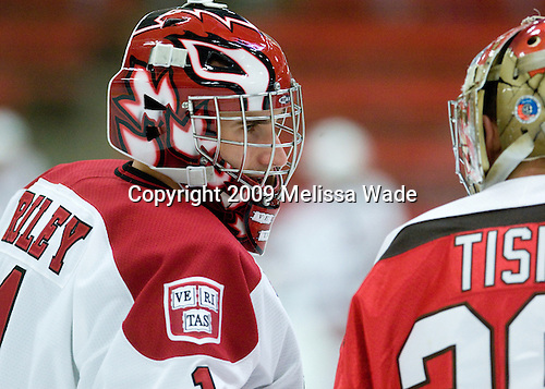 John Riley (Harvard - 1) and Kain Tisi (St. Lawrence - 29) chat at the red line during warmups. - The St. Lawrence University Saints defeated the Harvard University Crimson 3-2 on Friday, November 20, 2009, at the Bright Hockey Center in Cambridge, Massachusetts.