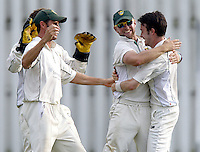 Matt Davis (R) is mobbed after taking the wicket of Dhiren de Silva during the Middlesex County Cricket League Division Two game between Harrow St Mary's and Shepherds Bush at<br /> Harrow on Sat July 19, 2014