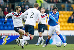 St Johnstone v Rangers...14.01.12  .Fran Sandaza is closed down by Sasa Papac, Dorin Goian and Steve Davis.Picture by Graeme Hart..Copyright Perthshire Picture Agency.Tel: 01738 623350  Mobile: 07990 594431