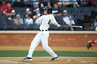DJ Poteet (4) of the Wake Forest Demon Deacons follows through on his swing against the North Carolina State Wolfpack at David F. Couch Ballpark on April 18, 2019 in  Winston-Salem, North Carolina. The Demon Deacons defeated the Wolfpack 7-3. (Brian Westerholt/Four Seam Images)