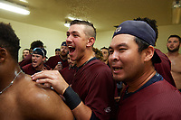 Mahoning Valley Scrappers Nolan Jones (10) and Ping-Hsueh Chen (17) celebrate in the locker room after winning the division title during the second game of a doubleheader against the Batavia Muckdogs on September 4, 2017 at Dwyer Stadium in Batavia, New York.  Mahoning Valley defeated Batavia 6-2 to clinch the Pinckney Division Title.  (Mike Janes/Four Seam Images)