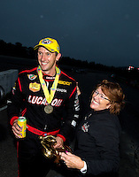 Aug 17, 2014; Brainerd, MN, USA; NHRA top fuel dragster driver Morgan Lucas (left) celebrates with his mother Charlotte Lucas after winning the Lucas Oil Nationals at Brainerd International Raceway. Mandatory Credit: Mark J. Rebilas-