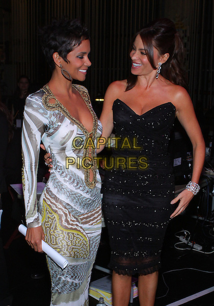HALLE BERRY & SOFIA VERGARA.The 42nd NAACP Image Awards - Backstage  held at The Shrine Auditorium, Los Angeles, California, USA..March 4th, 2011.half 3/4 length gold dress belly button navel low cut cleavage silver plunging neckline print white cut out long sleeve profile strapless black profile beads beaded viagra.CAP/ADM/TC.©T. Conrad/AdMedia/Capital Pictures.