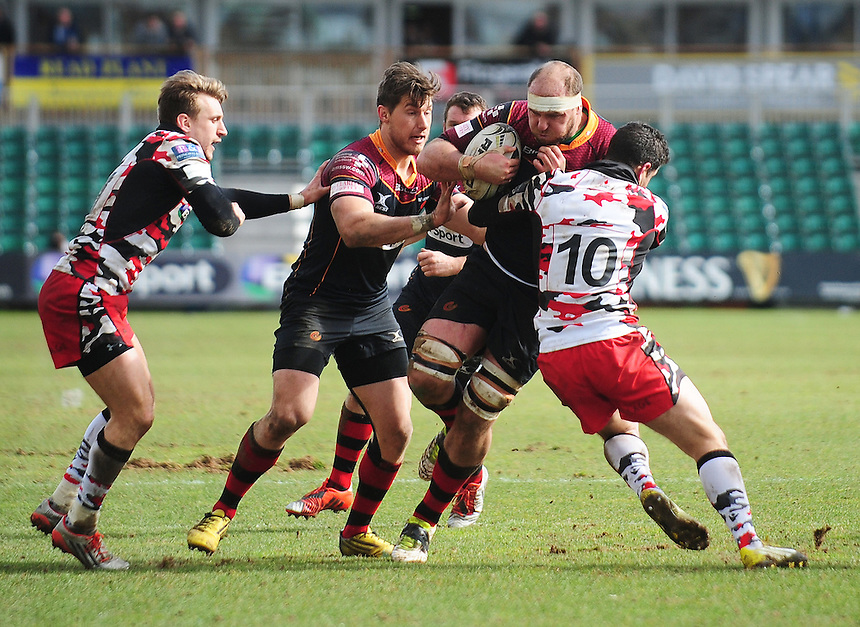 Dragons' Cory Hill is tackled by Edinburgh's Phil Burleigh<br /> <br /> Photographer Kevin Barnes/CameraSport<br /> <br /> Rugby Union - Guinness PRO12 Round 18 - Newport Gwent Dragons v Edinburgh Rugby - Sunday 27th March 2016 - Rodney Parade - Newport<br /> <br /> &copy; CameraSport - 43 Linden Ave. Countesthorpe. Leicester. England. LE8 5PG - Tel: +44 (0) 116 277 4147 - admin@camerasport.com - www.camerasport.com