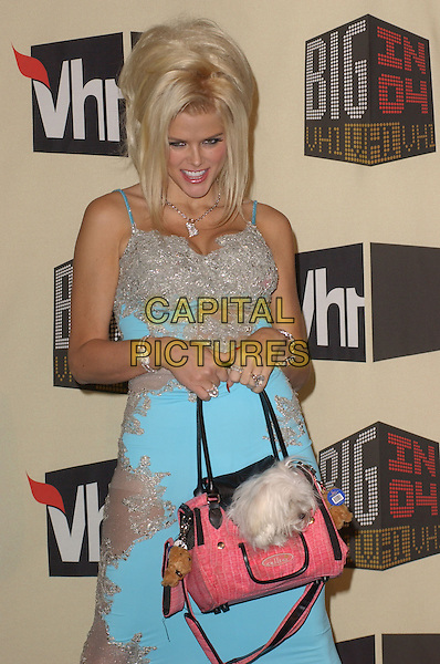 ANNA NICOLE SMITH.The VH1 Big in 04  Award Show held at The Shrine Auditorium in Los Angeles, California .December 1, 2004.half length, blue dress, bag, purse, animal, dog, pet.www.capitalpictures.com.sales@capitalpictures.com.Supplied by Capital Pictures
