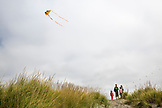 USA, Washington State, Long Beach Peninsula, International Kite Festival, family stands on the dunes and watches the kite festival