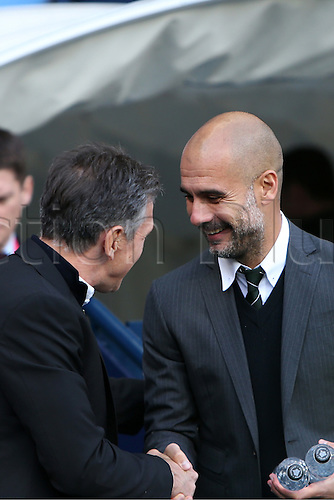 23.10.2016. The Etihad, Manchester, England. Premier League Football. Manchester City versus Southampton. Claude Puel, manager of Southampton shakes hands with Pep Guardiola, manager of Manchester City