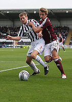 David van Zanten and Arvydas Novikovas tussle in the St Mirren v Heart of Midlothian Clydesdale Bank Scottish Premier League match played at St Mirren Park, Paisley on 15.9.12.