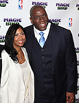"Magic Johnson & wife pictured at the ""Magic/Bird"" Opening Night Arrivals at the Longacre Theatre in New York City on April 11, 2012 © Walter McBride / WM Photography  Ltd."