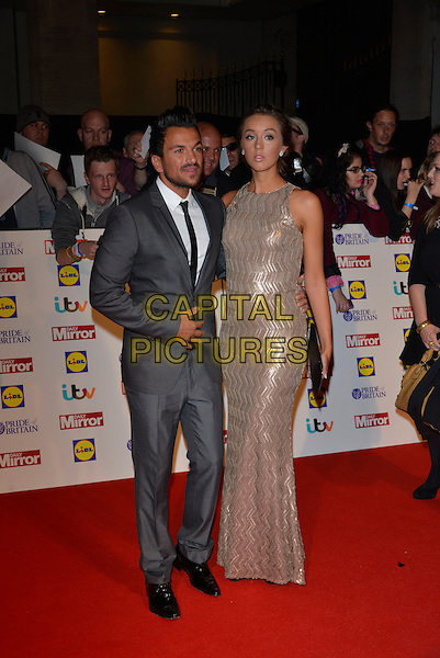 Peter Andre and Emily MacDonagh<br /> The Daily Mirror's Pride of Britain Awards arrivals at the Grosvenor House Hotel, London, England.<br /> 7th October 2013<br /> full length dress silver gold sleeveless grey gray suit pregnant couple <br /> CAP/PL<br /> &copy;Phil Loftus/Capital Pictures