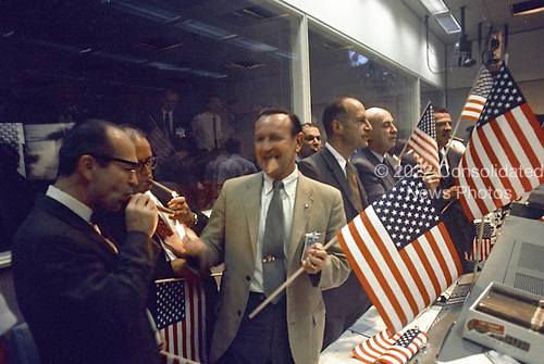 Houston, TX - (FILE) -- National Aeronautics and Space Administration (NASA) and Manned Spacecraft Center (MSC) officials join the flight controllers in celebrating the conclusion of the Apollo 11 mission on July 24,1969. From left foreground Dr. Maxime A. Faget, MSC Director of Engineering and Development; George S. Trimble, MSC Deputy Director; Dr. Christopher C. Kraft Jr., MSC Director fo Flight Operations; Julian Scheer (in back), Assistant Adminstrator, Office of Public Affairs, NASA HQ.; George M. Low, Manager, Apollo Spacecraft Program, MSC; Dr. Robert R. Gilruth, MSC Director; and Charles W. Mathews, Deputy Associate Administrator, Office of Manned Space Flight, NASA HQ..Credit: NASA via CNP