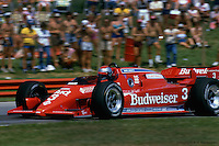LEXINGTON, OH - SEPTEMBER 2: Mario Andretti drives his  Lola T800/Cosworth en route to victory in the CART IndyCar event on September 2, 1984, at the Mid-Ohio Sports Car Course near Lexington, Ohio.
