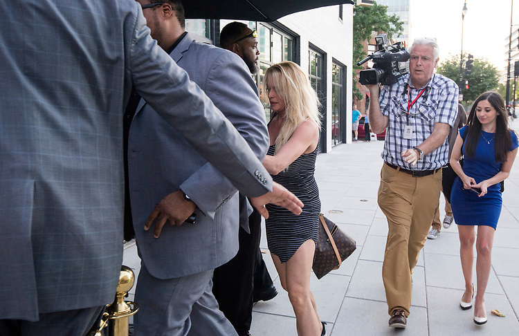 UNITED STATES - JULY 9: Stephanie Clifford, also known as adult film star and director Stormy Daniels, arrives for her first night of her two-night appearance surrounded by security at The Cloakroom strip club in Washington on Monday, July 9, 2018.(Photo By Bill Clark/CQ Roll Call)